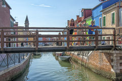 Colorful houses and canal on Burano island, Venice, Italy. Stock Photos