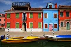 Colorful houses by canal in Burano, Venice, Italy. stock photography