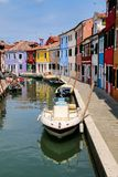 Colorful houses by canal in Burano, Venice, Italy. Burano is an island in the Venetian Lagoon and is known for its lace work and brightly colored homes stock photos