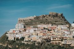 Colorful houses and a castle of Bosa town in Sardinia royalty free stock images