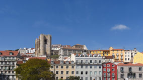 Colorful houses and cathedral in Lisbon, Royalty Free Stock Photos