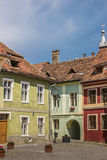 Colorful houses at the central square in Sighisoara Stock Photography