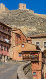 Colorful houses and city wall in Albarracin Stock Image
