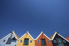 Colorful houses at the coast in Holland with a blu Stock Images