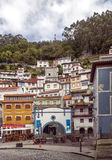 Colorful houses in Cudillero. Colorful houses located next to each other under the trees of the forest. They are located in the Spanish town of Cudillero in stock image
