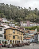 Colorful houses in Cudillero. Colorful houses located next to each other under the trees of the forest. They are located in the Spanish town of Cudillero in stock photography