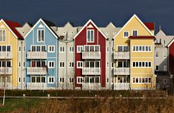 Colorful houses with dark sky. Colorful houses (swedish style) in red, blue and yellow with dark sky Royalty Free Stock Photos
