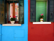 Colorful houses in Europe. Colorful houses with plants outside windows Stock Images