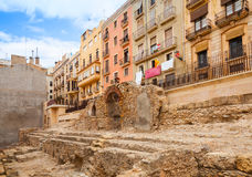 Colorful houses facades and old ruined fortress walls Stock Photos