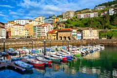 Colorful houses in Mutriku port and Old town, Basque country, Sp. Colorful houses and fishing boats in Mutriku old town port, Basque country, Spain stock images