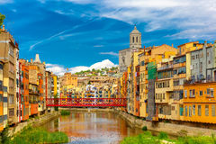 Colorful houses in Girona, Catalonia, Spain. Colorful yellow and orange houses and Eiffel Bridge, Old fish stalls, reflected in water river Onyar, in Girona royalty free stock photo