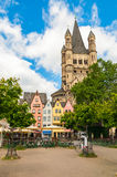 Colorful houses and Great St. Martin Church Cologne, Germany Stock Photo