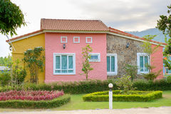 Colorful houses. The colorful houses with green grass garden found near the road royalty free stock photos