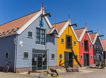 Colorful houses at the harbor of Zoutkamp Stock Photos