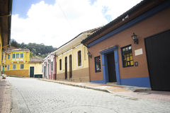Colorful houses at La Candelaria in Bogotá. Perspective view of a street with colonial houses at the historical district know as La Candelaria in Bogota Stock Image