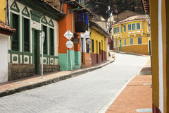Colorful houses at La Candelaria in Bogotá. Perspective view of a street with colonial houses at the historical district know as La Candelaria in Bogota Stock Photography