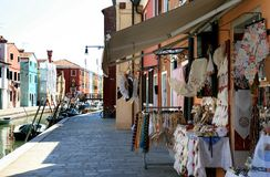 Colorful houses and lace selling at Burano, Italy Stock Images