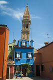 Colorful houses and leaning tower, Burano, Italy Stock Photos