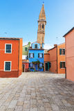 Colorful houses and the leaning tower of the church Burano Royalty Free Stock Photography