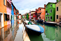 Colorful houses lined along the canal at Burano island, Venice Stock Photo