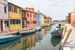 Colorful houses lining the canal Burano, Italy Stock Image