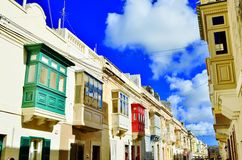 Colorful houses in Malta. Walking pass through street with many colorful houses / balconies. Sunny day with blue sky. Rabat - Victoria, Malta Stock Images