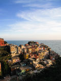 Colorful houses , Manarola, in sunshine evening. Many old colorful traditional Italian houses on hillside in Manarola, a fisherman village of Cinque Terre in the Royalty Free Stock Images