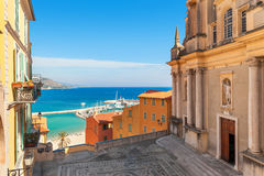 Colorful houses and Mediterranean sea in Menton. Stock Image