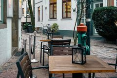 Colorful houses and narrow streets with Christmas decoration and lights in historic Schnoorviertel in Bremen. Christmas trees, wooden table, candlesticks stock photography