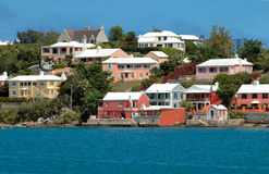 Colorful houses on the ocean in Bermuda. Colorful houses with typical white roofs in Bermuda Stock Photo