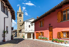 Colorful houses and old church in small italian town. Stock Photo