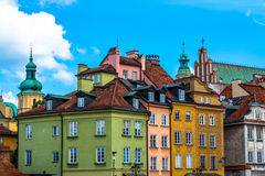 Colorful houses in the old town in Warsaw at the castle square. Sunny summer day with a blue sky. Stock Photo