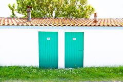 Colorful houses of oyster farmers and fishermen in the Bay of Arcachon Stock Images