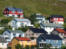 Colorful houses - quaint town. Picturesque village on a hillside. Norwegian townscape Stock Image