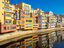 Colorful houses reflected in water, Girona, Catalonia, Spain Stock Photo