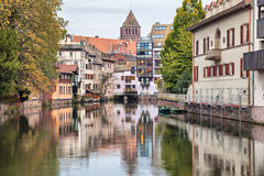 Colorful houses reflecting in water of river Ill in Strasbourg Stock Images