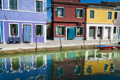 Colorful houses and reflections, Burano, Italy Stock Photography