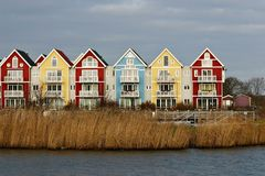 Colorful houses beside a river. (swedish style) in red, blue and yellow Royalty Free Stock Image