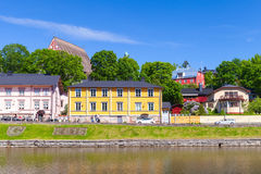 Colorful houses on the river coast in Finnish town Royalty Free Stock Photo