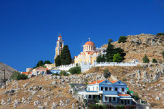 Colorful houses on rocks.Island Symi.Greece. Royalty Free Stock Photo
