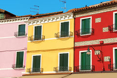 Colorful houses in a row on Burano Island Stock Photo