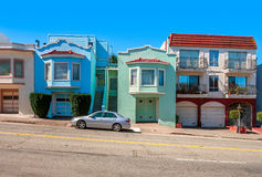 Colorful houses on sloping street in San Francisco. Stock Photo