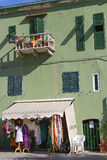 Colorful houses in the small harbor of Giglio Island Stock Photos