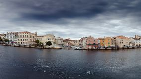 Canal in Venice and houses. Panorama. Colorful houses standing on the banks of the canal in Venice. Black clouds. The rain is coming. Photo can become cover or Stock Photos