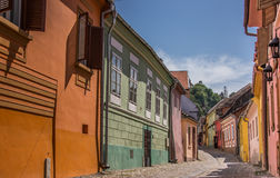 Colorful houses in a street in central Sighisoara Stock Images