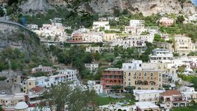 Colorful houses and streets on the hill in Positano. Amalfi Coast, Italy on August 16, 2019. Pan stock video
