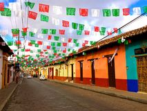 Colorful houses in typical colonial street of San Cristobal de las Casas. Royalty Free Stock Photo
