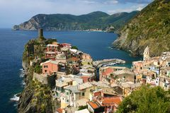 Colorful houses of Vernazza. Colorful houses piled on a rocky nose on the coast line Royalty Free Stock Images