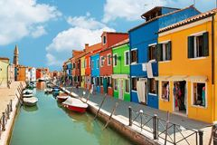 Colorful houses by the water canal at the island Burano near venice, Italy Royalty Free Stock Images