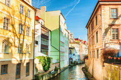 Colorful houses on the water channel in Prague Stock Image